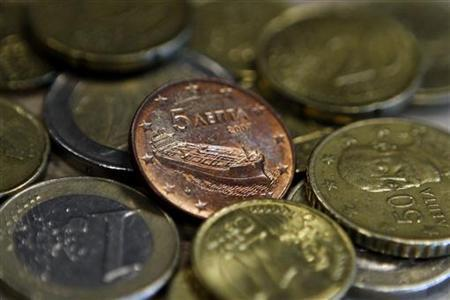 A Greek five-cent euro coin depicting a tanker is seen amongst other coins in Athens February 15, 2012. Top Greek refiner Hellenic Petroleum said on Wednesday it had not been informed of a cut in Iranian oil exports to Greece but that it was confident of finding alternative sources of fuel if needed. Iran has stopped oil exports to six European states including Greece in retaliation for European Union sanctions imposed on the Islamic state's key export, its English-language Press TV reported.   REUTERS/Yiorgos Karahalis (GREECE - Tags: ENERGY BUSINESS SOCIETY POLITICS)