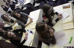 Russian-speaking students attend a Russian literature lesson in a school in Riga February 15, 2012. More than 180,000 Russian-speaking Latvian citizens have signed to initiate a national referendum, which would be put to vote on Saturday, on making Russian an official state language alongside Latvian. REUTERS/Ints Kalnins