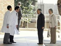 Japanese Emperor Akihito (2nd R) and Empress Michiko (R) are greeted by doctors upon their arrival at the entrance of the University of Tokyo Hospital in Tokyo February 17, 2012. Emperor Akihito was admitted to a Tokyo hospital on Friday to prepare for heart surgery set for Saturday. Akihito, 78, has been receiving treatment for heart problems for the past year, and doctors decided last week that he needs a coronary bypass operation. REUTERS/Toshifumi Kitamura/Pool