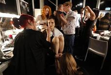 A model has her hair styled, her makeup applied and her toenails painted backstage before the presentation of the Felder Felder Autumn/Winter 2012 collection during London Fashion Week February 17, 2012. REUTERS/Suzanne Plunkett