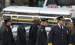 Pall-bearers carry the casket of pop singer Whitney Houston to a hearse following her funeral service at the New Hope Baptist Church in Newark, New Jersey February 18, 2012. Houston, 48, died in a Beverly Hills hotel room on February 11, the eve of the music industry's Grammy Awards. REUTERS/Lucas Jackson