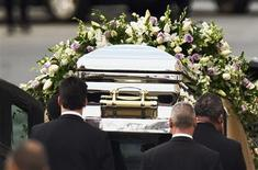 Pall-bearers load the casket of pop singer Whitney Houston into a hearse following her funeral service at the New Hope Baptist Church in Newark, New Jersey February 18, 2012. Houston, 48, died in a Beverly Hills hotel room on February 11, the eve of the music industry's Grammy Awards. REUTERS/Lucas Jackson