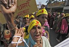 Local activists attend a demonstration to mark the 25th anniversary of the Bhopal gas disaster in Bhopal December 3, 2009. REUTERS/Reinhard Krause