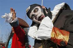 Carnival revellers perform during the Ovar city parade February 19, 2012. Dozens of Portuguese cities continue their celebration of the carnival weekend, despite the government's decision to cancel the holiday due to austerity measures. REUTERS/Jose Manuel Ribeiro