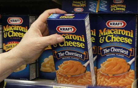A woman grabs a box of Kraft Macaroni & Cheese from a shelf at a Walgreens store in Willowbrook, Illinois January 19, 2010. REUTERS/Frank Polich