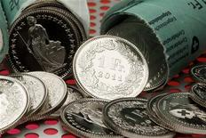 One Swiss Franc coins are seen in this illustration picture in Zurich August 10, 2011. REUTERS/Arnd Wiegmann