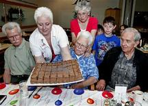 "John ""Jack"" Babcock receives a cake to celebrate his 108th birthday in Spokane, Washington, July 23, 2008."