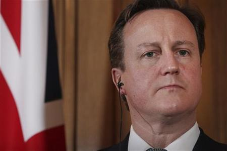Britain's Prime Minister David Cameron listens during a joint news conference with Spain's Prime Minister Mariano Rajoy in 10 Downing Street in central London February 21, 2012. REUTERS/Peter Macdiarmid/Pool