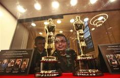 """Oscar statuettes are on display during the opening of """"Meet the Oscars"""" exhibition at Grand Central Station in New York, February 22, 2012. REUTERS/Brendan McDermid"""