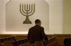 A member of the Jewish community attends a service at the synagogue in Berlin's Pestalozzi Street November 7, 2008. REUTERS/Fabrizio Bensch
