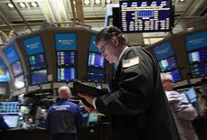 Traders work on the floor of the New York Stock Exchange February 21, 2012. REUTERS/Brendan McDermid
