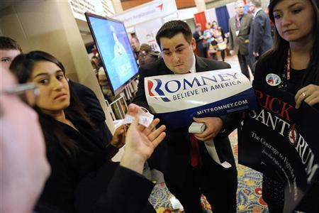 A supporter of Mitt Romney hands out campaign stickers at the American Conservative Union's annual Conservative Political Action Conference in Washington, February 11, 2012. REUTERS/Jonathan Ernst