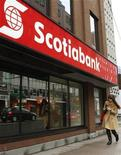 A woman walks past the Scotiabank on Spring Garden road in Halifax, Nova Scotia, March 3, 2009. REUTERS/Paul Darrow
