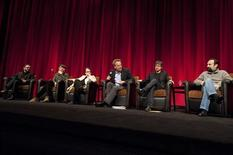 """(L-R) Directors Michael Roskam of """"Bullhead"""" from Belgium, Joseph Cedar of """"Footnote"""" from Israel, Agnieszka Holland of """"In Darkness"""" from Poland, host and member of the Academy Award's Board of Governors Mark Johnson, Philippe Falardeau of """"Monsieur Lazhar"""" from Canada and Asghar Farhadi of """"A Separation"""" from Iran attend the Foreign Language Film Award symposium for the 84th Academy Awards, in the Grand Lobby of the Samuel Goldwyn Theater in Beverly Hills, California February 25, 2012. The Oscars will be presented on February 26 at the Hollywood & Highland Center in Hollywood. REUTERS/Darren Decker/AMPAS/Handout"""