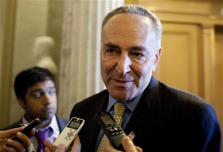 Senator Charles Schumer (D-NY) speaks to the media before voting on a bill allowing a rise in the debt ceiling on Capitol Hill in Washington August 2, 2011.  REUTERS/Joshua Roberts