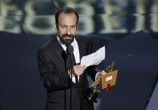 """Asghar Farhadi, director of Iranian film """"A Separation"""" accepts the Oscar for Best Foreign Language Film at the 84th Academy Awards in Hollywood, February 26, 2012.  REUTERS/Gary Hershorn"""