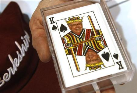 A woman displays playing cards for sale with a picture of Berkshire Hathaway Chairman Warren Buffett as the king of spades at a souvenir stand at the company trade show during the BH annual meeting in Omaha, Nebraska April 30, 2011. REUTERS/Rick Wilking/Files