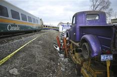 A VIA passenger train that derailed is pictured in Burlington, Ontario, February 26, 2012. The VIA Rail train, which was travelling from Niagara Falls to Toronto with about 75 passengers, derailed at 1530 EST (2030 GMT), killing at least one person, according to media reports.  REUTERS/J.P. Moczulski
