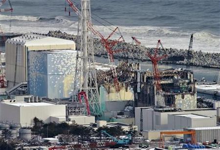 Tokyo Electric Power Co. (TEPCO)'s tsunami-crippled Fukushima Daiichi nuclear power plant's (R to L) No.4, No.3 No.2 and No.1 reactor buildings are seen in Fukushima prefecture, in this aerial view photo taken by Yomiuri Shimbun February 26, 2012. REUTERS/Yomiuri Shimbun