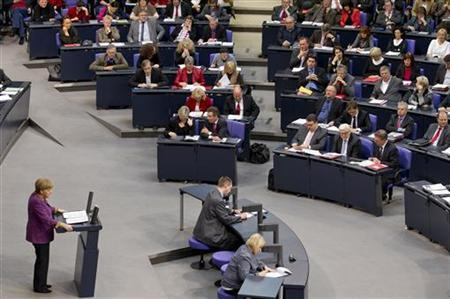 German Chancellor Angela Merkel speaks during a debate before a parliamentary vote on a Greek bailout package in the Bundestag, the lower house of parliament, in Berlin , February 27, 2012.  Germany's parliament was almost certain to endorse a second Greek bailout on Monday but Chancellor Angela Merkel was torn between domestic pressure to stop throwing good money after bad and global calls to boost Europe's crisis defences.  REUTERS/Thomas Peter (GERMANY - Tags: POLITICS BUSINESS)