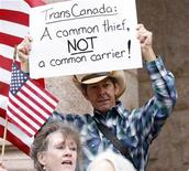 A man holds a sign at a rally in front of the Lamar County courthouse where landowner Julia Trigg Crawford is set to go to court in a battle with TransCanada over the trenching of her private property for the Keystone pipeline in Paris, Texas February 17, 2012.  REUTERS/Mike Stone