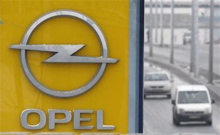 The logo of the carmaker Opel is seen on a roadside in Istanbul February 17, 2012. REUTERS/Osman Orsal (TURKEY - Tags: TRANSPORT BUSINESS EMPLOYMENT LOGO)