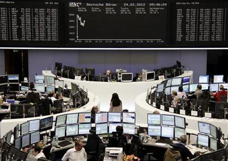 Traders are pictured at their desks in front of the DAX board at the Frankfurt stock exchange February 24, 2012.  REUTERS/Remote/Kirill Iordansky  (GERMANY - Tags: BUSINESS)