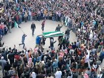 Anti-government protesters attend the funeral of Jaffar Mahmoud, whom they said was killed during clashes with government troops in earlier protests against Syria's President Bashar al-Assad, in Marat al-Numan near the northern province of Idlib February 27, 2012.  REUTERS/Handout