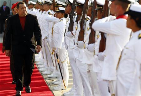 Venezuela's President Hugo Chavez is seen before boarding the plane before his departure to Cuba, in Caracas February 24, 2012.  REUTERS/Jorge Silva