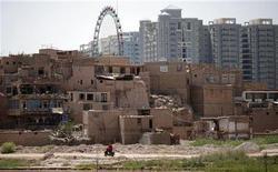 Вид на город Кашгар в Синьцзяне, 4 августа 2011 г. Тринадцать человек погибли в результате нападения вооруженных ножами преступников в этнически разделенном китайском Синьцзян-Уйгурском автономном районе (СУАР), семь нападавших были убиты, сообщили местные власти. REUTERS/Carlos Barria