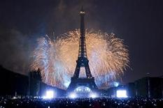 The Eiffel Tower is illuminated during the traditional Bastille Day fireworks display in Paris July 14, 2011. REUTERS/Gonzalo Fuentes