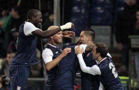 Clint Dempsey (2nd L) of the U.S. celebrates with teammates after scoring against Italy in their international friendly soccer match at the Luigi Ferraris stadium in Genoa, February 29, 2012. REUTERS/Stefano Rellandini