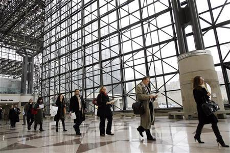People walk in line to register for the 2009 CUNY Big Apple Job Fair at the Jacob K. Javits Convention Center in New York March 20, 2009.    REUTERS/Shannon Stapleton