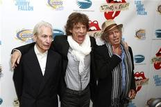 """Rolling Stones band members (L-R) Charles Watts, Mick Jagger, and Keith Richards pose as they arrive for the premiere of the documentary film """"Stones In Exile"""" in New York May 11, 2010. REUTERS/Lucas Jackson"""