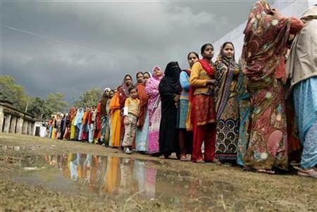 Voters line up in a queue outside a polling booth to cast their vote during the state assembly election in Haraiya town, in the northern Indian state of Uttar Pradesh February 8, 2012. REUTERS/Jitendra Prakash