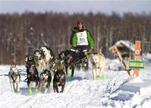 Jaimee Kinzer of Willow and his team head to Nome during the 40th Iditarod Trail Sled Dog Race in Willow, Alaska March 4, 2012. REUTERS/Wayde Carroll