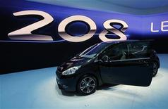 The new Peugeot 208 model car is displayed during the first media day of the Geneva Auto Show at the Palexpo in Geneva, March 6, 2012. The Geneva Auto Show will take place from March 8 to 18, 2012.  REUTERS/Denis Balibouse