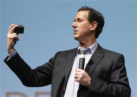 Rick Santorum displays a piece of North Dakota shale while speaking to supporters during an event at the Curb Center on Belmont University's campus in Nashville, Tennessee, February 29, 2012. REUTERS/Harrison McClary