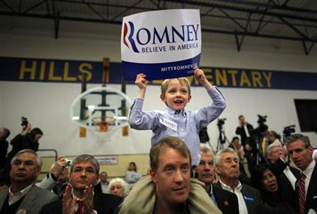 A boy cheers before the start of a campaign rally with Mitt Romney in Knoxville, Tennessee March 4, 2012. REUTERS/Brian Snyder