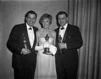 "Songwriters Richard M. Sherman (L) and Robert B. Sherman, winners for best song and best score for ""Mary Poppins,"" pose with best actress winner for her role in the same film Julie Andrews backstage at the 37th Academy Awards, April 5, 1965. Disney songwriter Robert Sherman, part of a team with brother Richard responsible for numerous film scores and children's songs, died in London on Monday aged 86. REUTERS/AMPAS/Handout"