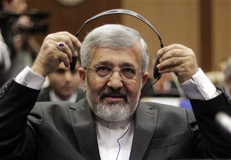 Iran's International Atomic Energy Agency (IAEA) ambassador Ali Asghar Soltanieh adjust his headphones as he attends a board of governors meeting at the United Nations headquarters in Vienna March 5, 2012. REUTERS/Herwig Prammer