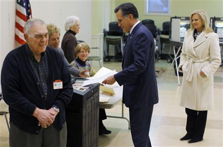 Mitt Romney casts his ballot in the Massachusetts primary, as his wife Ann looks on in Belmont, Massachusetts March 6, 2012.  REUTERS/Brian Snyder