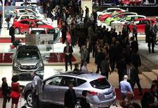 Visitors walk around booths during the second media day of the 82nd Geneva Auto Show at the Palexpo Arena in Geneva March 7, 2012. The Geneva Motor Show will take place form March 8 to 18, 2012. REUTERS/Denis Balibouse