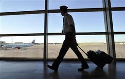 An Air Canada pilot walks to his plane at the International airport in Calgary, September 20, 2011. REUTERS/Todd Korol