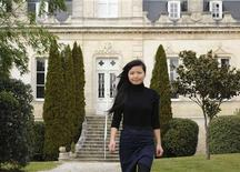Li Lijuan, the 28-year old Chinese woman in charge of managing the Grand Moueys property in the absence of Chinese businessman Jin Shan Zhang, walks in front of the Chateau du Grand Moueys in Capian March 7, 2012. REUTERS/Caroline Blumberg (FRANCE - Tags: BUSINESS SOCIETY)
