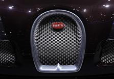 A Bugatti logo is pictured on the new Veyron Grand Sport car during the second media day of the 82nd Geneva Auto Show at the Palexpo Arena in Geneva March 7, 2012. REUTERS/Denis Balibouse