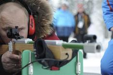 """Russian Prime Minister and President-elect Vladimir Putin takes aim with a rifle for the partially sighted during a visit to meet disabled athletes training in the """"Laura"""" biathlon and cross-country skiing complex in Sochi March 9, 2012. REUTERS/Alexsey Druginyn/RIA Novosti/Pool"""