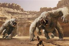 """Taylor Kitsch and the white apes in a scene from """"John Carter"""". REUTERS/Disney"""