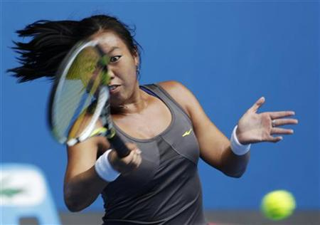 Vania King of the U.S. hits a return to Ana Ivanovic of Serbia during their women's singles match at the Australian Open tennis tournament in Melbourne January 21, 2012. REUTERS/Darren Whiteside