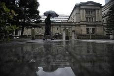 A man walks past the Bank of Japan headquarters in Tokyo February 14, 2012. REUTERS/Toru Hanai